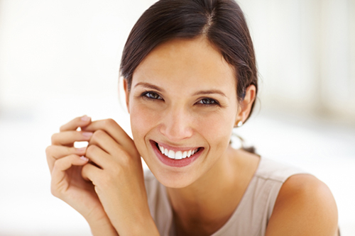 Woman smiling after a comfortable dental procedure using soft tissue laser